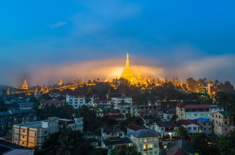 Shwedagon Paya pagoda in Gold Mist in the morning before sunrise .Myanmar famous sacred place and tourist attraction landmark.Yangon, Myanmar